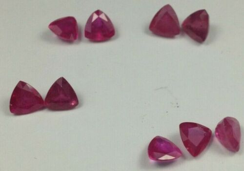 9 Hybrid (filled) rubies, 6mm on a side triangles, 3 pairs and 3 unmatched stone