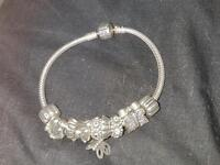 Genuine Pandora Bracelet with five charms including shiny buttery and Buddha