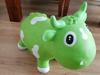 Kids jumping cow