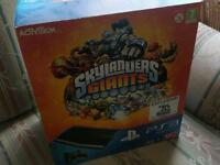 PLAYSTATION 3 WITH SKYLANDER GIANTS AND 2 MORE GAMES