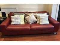 Ox blood red Italian leather 4 seat sofa and chair.