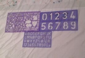 SET OF THREE PLASTIC STENCILS. LETTERS, NUMBERS AND SHAPES. NEW CONDITION.