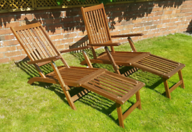 Pair of solid wood steamer chairs with cushions