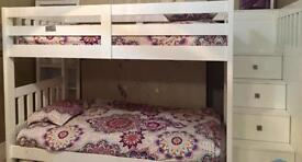 Bunk bed with storage drawers.