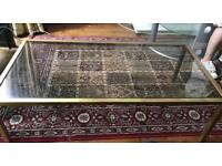 Glass top coffee table with brass frame