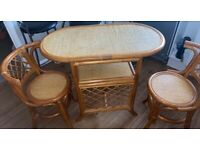 Two seater wooden table and chairs.