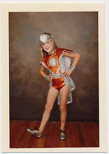 Vintage snapshot. Young little girl in cute dance costume. 70s color photo.