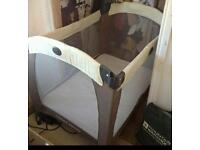 Graco cream and brown travel cot with changer