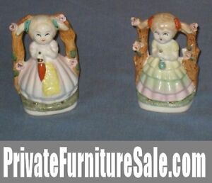 Pair of matching Ceramic Statues/figurines of 2 Girls
