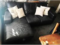 L-shape leather sofa with matching pouffe