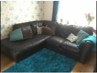 Dark brown leather corner sofa in good condition