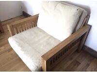 Solid oak single sofa bed by Futon company with trifold mattress, pillow and cover