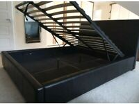 Excellent condition ottoman black leather gas lift king size bed with storage underneath.