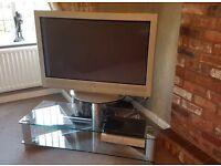 """Sony 46"""" plasma TV with glass stand."""