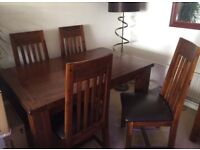 Small extending dining room table and 4 chairs