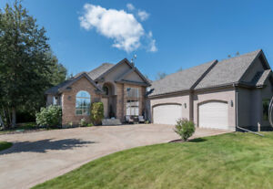 BREATHTAKING ACREAGE BACKING NORTHERN BEAR GOLF COURSE
