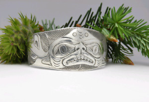 Hand engraved bracelet,  Dogfish showing off his new teeth.
