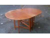 Wooden 6 - 8 seater drop leaf dining table, Chestnut in colour