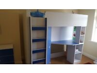 Bed with wardrobe