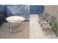 Round folding garden table and four chairs