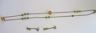 60s -70s Jewelry – Necklaces, Earrings, Rings, Bracelets Vintage 1960's era Necklace Earrings Set Gold with Green Yellow Beads $7.00 AT vintagedancer.com