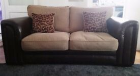 Leather and material mixed sofa. In good condition.
