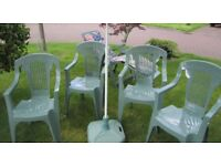 Keter garden furniture comprises 4 chairs, lounger with cushion and parasol & base in green.