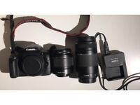 Canon 550D, 18-55mm lens, 75-300mm lens, battery charger and a bag/ perfect condition
