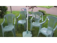 Keter garden furniture comprises 4 chairs, lounger with cushion, parasol & base in green.