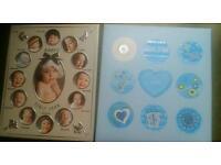 Baby frame and photo album set.