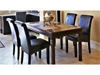 Solid wood dinning table and 4 leather chairs. Mint condition. £120 for quick sale