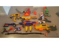 Nerf Guns collection for sale - loads of attachments and ammo + box