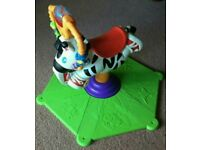 FISHER PRICE ZEBRA BOUNCE AND SPIN TO MUSIC