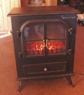 Heater  electric  with  burning  log effect, and fan ..very cosy
