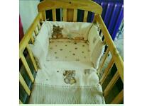 Mamas and papas swinging crib with bedding