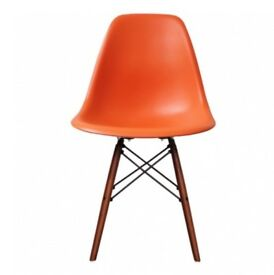 Brand new orange Eames chair with walnut wooden legs