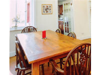 Large solid wood dining table