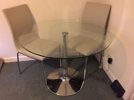 Round glass dining room table and chairs