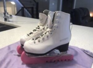 Size 9 figure skates with blade covers