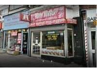 kebab and pizza shop with 2 flats for sale