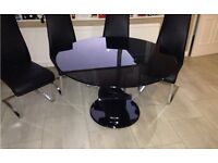 Black Barker & Stonehouse circle dining table and chairs