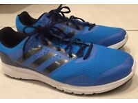 Very large Adidas running shoes: new, size 14.5 UK unused