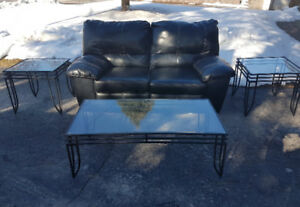 Black Leather Power Reclining Love Seat With 3 Glass Tables.