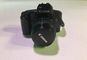 Canon ELAN 35mm film camera with two lenses
