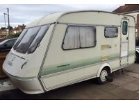 Caravan 2 Berth with awning and accessories. May deliver