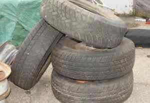 Set of four good snow tires and rims for dauly van