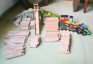 Huge lot of wooden train tracks and trains