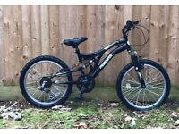 Boys muddy Fox mountain bike