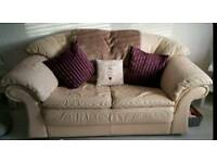 2 cream leather sofas