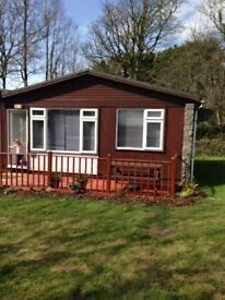 Holiday in Cornwall Devon border chalet near Bude,set in lovely manor house grounds allows dogs